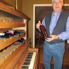 Derek Gibson keeps wine that he made in a piano-framed wine cellar that he made.