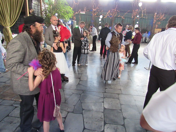 Staff photo by Cathy Spaulding<br /> Fathers and daughters fill a dance floor at The Castle of Muskogee during Saturday afternoon's Daddy Daughter dance.