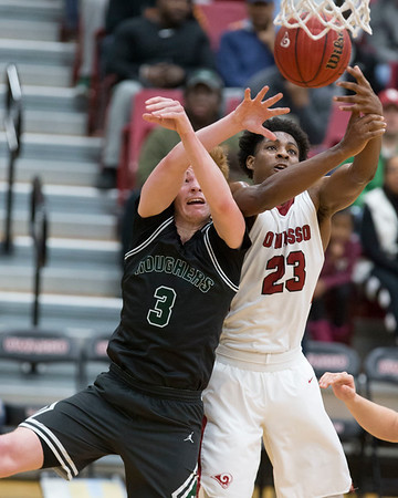 Phoenix special photo by Von Castor<br /> Muskogee's Brooks Haddock is fouled by Owasso's Josh Proctor on an offensive rebound late in the fourth quarter Saturday at Owasso.
