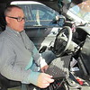 CATHY SPAULDING/Muskogee Phoenix<br /> Fort Gibson Police Chief Rob Frazier explains how laptops work inside police cruisers. He said more of police work is going paperless.