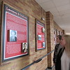 CATHY SPAULDING/Muskogee Phoenix<br /> Fort Gibson High School History Club members Siera O'Daniel, left, and Samantha Fugate study Fort Gibson history panels they helped write. The panels are in a hall by the FGHS gym.