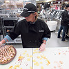 Staff photo by Cathy Spaulding<br /> Sheila Hart assembles turkey and smoked gouda cheese bites in the deli department of the new Harps Food Store.