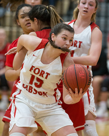 Phoenix special photo by Von Castor<br /> Fort Gibson's Zoe' Shieldnight grabs a one-handed offensive rebound while being held by Stillwell's Plizia Bishop during first half action Monday night in a Class 4A Area II regional championship game at Harrison Field House.