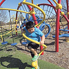 Staff photo by Cathy Spaulding<br /> Greyson Settlemyre of Fort Gibson climbs a twirling post at the Civitan Park playground Monday afternoon. Greyson's grandmother, Ruth Settlemyre, said Greyson was enjoying a day off from school.