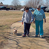Staff photo by Cathy Spaulding<br /> Marilyn Doss walks her poodle, Rosie, along the hilly trail at Civitan Park. Gwen Hytche joins them on their Monday afternoon walk.