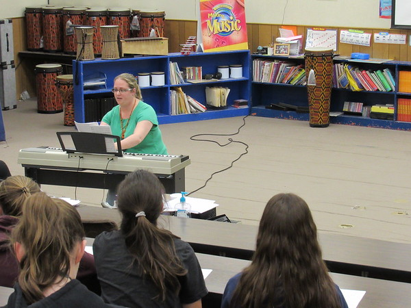 CATHY SPAULDING/Muskogee Phoenix<br /> Woodall music teacher Christina Herriman leads a class inside a Little Theater classroom that has old carpeting and shelves. A proposed $500,000 bond issue would help fund Little Theater renovations.