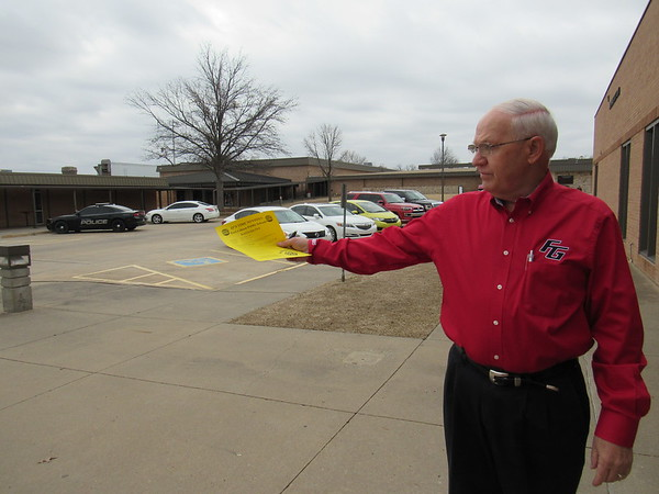 Staff photo by Cathy Spaulding<br /> Fort Gibson Schools Assistant Superintendent Tom Stiles shows how traffic and parking between the administration building and cafeteria would be moved if voters approve a $5.7 million bond package.