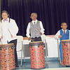 CATHY SPAULDING/Muskogee Phoenix<br /> New Tech at Cherokee Elementary students, from left, Leilani Jeffrion, Ken-Trail Walker and Anthony McNac play drums Thursday during the Black History Month Program.