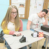 CATHY SPAULDING/Muskogee Phoenix<br /> Hilldale High School academic team members Mo Wright, left, and Michael Carlton demonstrate the new buzzer units funded by a Hilldale Education Foundation grant.