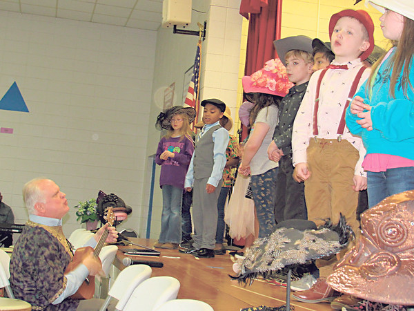 New Tech at Cherokee Elementary second-graders sing spirituals while<br /> music teacher Jared Johnson plays a ukulele during the school's Black<br /> History Month Program on Thursday.