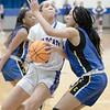 SHANE KEETER/Special to the Phoenix<br /> Checotah's Olivia Clayton, center, goes in against a Classen defender<br /> during Thursday's Class 4A, Area III regional semifinal.