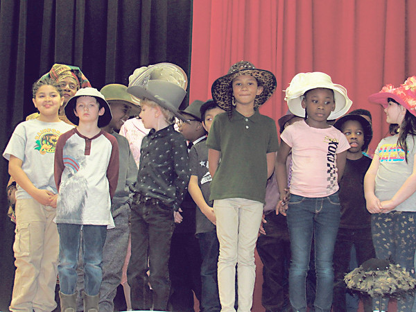 "CATHY SPAULDING/Muskogee Phoenix<br /> New Tech at Cherokee Elementary second-graders model fancy hats during the ""hatitude"" segment of the school's Black History Month Program, held Thursday."