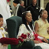 Staff photo by Cathy Spaulding<br /> Muskogee High School senior Jaceia Colbert sits between crown bearer Rylan Wilkerson and flower girl Aubreyon'tae Pride after being crowned MHS 2018 basketball homecoming queen. The coronation was held Friday afternoon.
