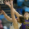 Phoenix special photo by Von Castor<br /> Oktaha's Matthew Fry, left, shoots over Weleetka's Blake Deal during Friday's game in Oktaha. The Tigers won 83-40.