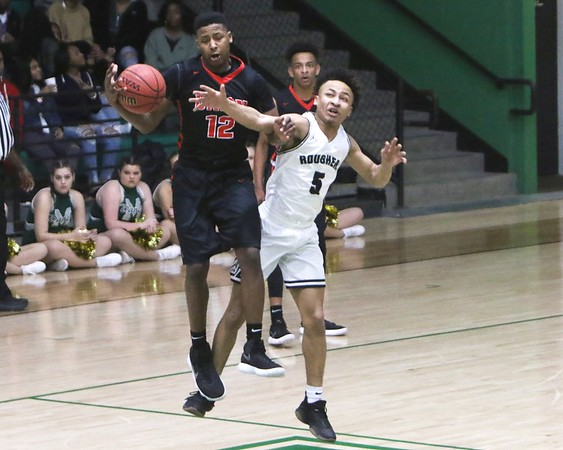 Phoenix special photo by John Hasler<br /> Muskogee's Cameron Clemmons, right, knocks the ball away from Tulsa Union's Jordan Flood on Friday at Ron Milam Gymnasium. The Roughers lost 57-38.