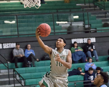 Phoenix special photo by Abigail Washington<br /> Muskogee's Ty Williams goes in for a layup against Bartlesville on Monday at Ron Milam Gymnasium. Williams led the Roughers with 16 points as Muskogee won 64-58.