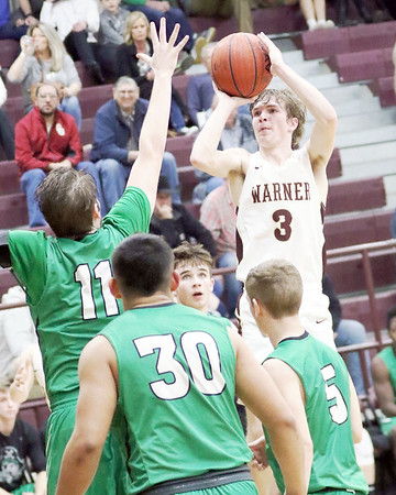 JOHN HASLER/Special to the Phoenix<br /> Warner's Nathan Ohl unleashes a 3 over the Gore defense during the Eagles' 63-53 win over the Pirates on Tuesday.