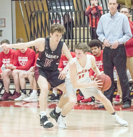 ABIGAIL WASHINGTON/Special to the Phoenix<br /> Fort Gibson's Andrew Storrs, right, dribbles around Wagoner's Jack Southern during the Tigers' 56-49 win over the Bulldogs on Tuesday at Harrison Field House.