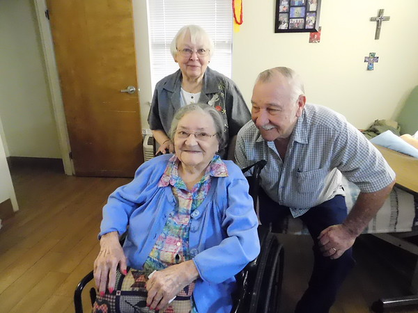 KENTON BROOKS/Muskogee Phoenix<br /> Bill Chaney and his wife Elaine spend time with Chaney's mother, Eliza Hatfield, at Eastgate Village Retirement Center before she celebrates her 100th birthday on Feb. 15. The Chaneys are 80 years old. A party is being planned for Hatfield's birthday.