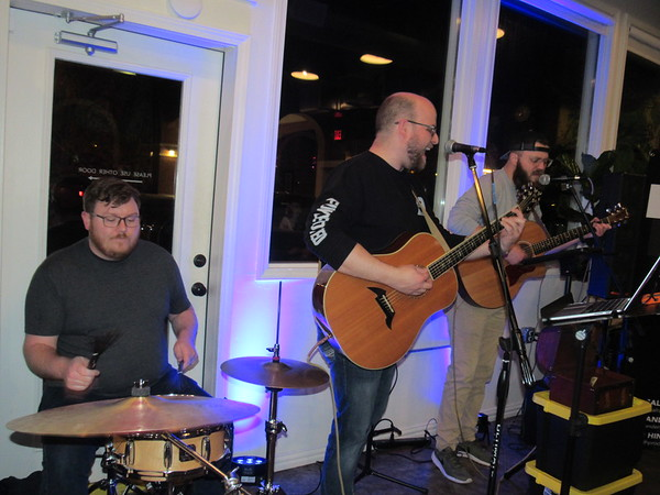 CATHY SPAULDING/Muskogee Phoenix<br /> Jason Hiner plays drums while bandmates Jon Vanderveer, center, and Micheal Rappe harmonize. The three, as the trio RB&H, performed at The Break earlier this week and will perform at Oklahoma Music Hall of Fame on Thursday.