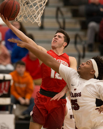 Phoenix special photo by Von Castor<br /> Fort Gibson's Carson Calavan, left, drives the lane as Wagoner's Chris Coulter defends during Tuesday's game in Wagoner. The Tigers won 63-53.