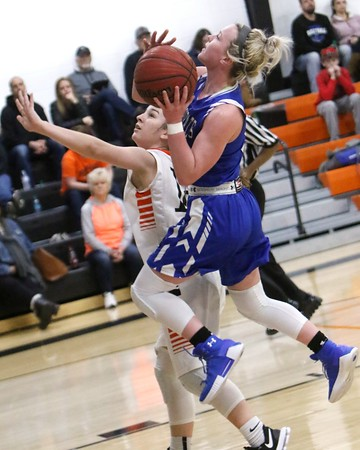 Phoenix special photo by John Hasler<br /> Porter's Lexie Conley, right, scores over Okay's Carmen Parnell during Tuesday's game in Okay.