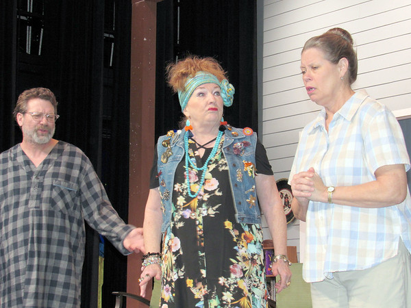 "CATHY SPAULDING/Muskogee Phoenix<br /> A pronouncement from psychic housekeeper Cassandra (Sarah Turner, center) worries aging siblings Vanya (Phil Sapienza) and Sonia (Linda Sapienza) in the Muskogee Little Theatre production of ""Vanya and Sonia and Masha and Spike."""