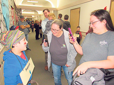 CATHY SPAULDING/Muskogee Phoenix Sequoyah (third-grader Kale Owen) smiles for Jill Owen, center, and Robin Owen during the Oklahoma Living History Museum, presented by Fort Gibson Intermediate Elementary third-graders.