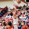 CHRIS CUMMINGS/Special to the Phoenix<br /> Hilldale's Brayson Lawson connects for the Hornets as teammate T.J. Maxwell looks on Friday night. Hilldale defeated Locust Grove 69-61.