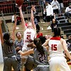 Phoenix special photo by John Hasler<br /> Fort Gibson's Reese Webb scores in a traffic jam of Lady Indians, who lost that battle but won the war in Thursday's game in Fort Gibson.