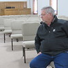 CATHY SPAULDING/Muskogee Phoenix<br /> First Baptist Church deacon chairman Rick Shelby sits on new chairs that replaced pews ruined by late May floods. The church will celebrate its recovery on Feb. 16.