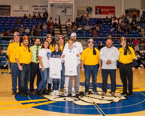 CHRIS CUMMINGS/Special to the Phoenix<br /> Brannon Westmoreland, a Haskell freshman, was honored by the Bedouin Shrine with a while jacket, connecting his stay as a patient at Shriners Hospital in Galveston, Texas, and being the 10th participant in the Bedouin Shrine Classic basketball tournament to have received care at one of the Shriner facilities. To the immediate left of him are his mother, Amy, his sister Riley, and behind him, his father, Brad. Others, from left, are potentate Davis Ross, tournament director Keith Olmstead, Haskell boys basketball coach Wes Hayes, Shriners Gene Foster, Steve Fletcher and Jeremy Schuler, Haskell superintendent Rusty Harris and longtime tournament officer Jim Bushnell.