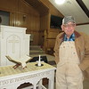 CATHY SPAULDING/Muskogee Phoenix<br /> First Baptist Church, Webbers Falls treasurer Bill Stricklin recalls working to preserve the pulpit's wood stain after it was damaged in May floods. The church ended up painting it.