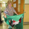 Staff photo by Cathy Spaulding<br /> Darla Ryan tears a decoration from her classroom door. The Alice Robertson Junior High teacher is retiring this month.