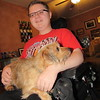 Staff photo by Cathy Spaulding<br /> Sejin Whittle holds Boomer, a family dog. Sejin,15, received help from Shriners Hospital for his muscular dystrophy.