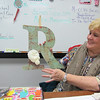 Staff photo by Cathy Spaulding<br /> Darla Ryan shows an initial R she decorated and used in her classroom at Alice Robertson Junior High. She is retiring from a lengthy education career.