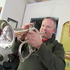 Staff photo by Cathy Spaulding<br /> Adam White practices a flugelhorn in his garage. He says the garage enables him to play his horns without blowing his family out of the house.""