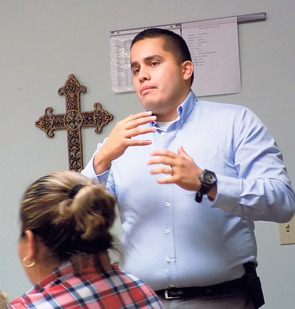 """Special photo by Mike Elswick<br /> City of Muskogee Police Department Community Resource Officer Joshua Garza visited with Spanish speaking participants in the 20-week """"Getting Ahead"""" program."""