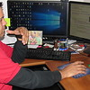 Staff photos by Cathy Spaulding<br /> Victor Lezama pulls up coding for a computer program. Girls in grades six through 12 need sponsors to help them take a class in basic computer  coding for free.