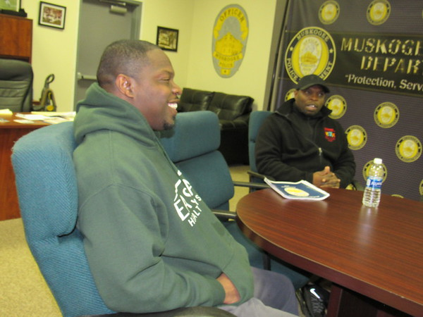 Staff photo by Cathy Spaulding<br /> Martin Luther King Parade grand marshals, Don Mayes, left, and Ron Mayes, talk about how they get youth involved in sports. They said sports kept them away from bad influences.