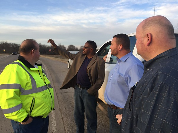 Staff photo by D.E. Smoot<br /> The Rev. Charles Moore, second from left, discusses concerns about an intersection at U.S. 69, where a member of his congregation was killed in 2014. Commissioners, from left, Stephen Wright, Ken Doke, and Kenny Payne.