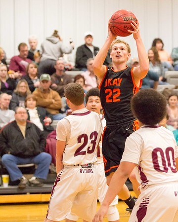 Phoenix special photo by Shane Keeter<br /> Okay's Kaleb Pierce, center, shoots for two between Webbers Falls' Tommy Coppin, left, and David Guinn in the first quarter of Friday's game at Webbers Falls.
