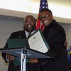 Special photo by Mike Elswick<br /> The Rev. Rodger L.B. Cutler, left, is congratulated during NAACP Muskogee Branch officer installation Friday night as the organization's incoming president by Rev. Charles Moore, who presented Cutler with a proclamation from the Oklahoma Legislature signed by State Rep. Avery Frix. The induction ceremony was held at St. Mark Baptist Church.