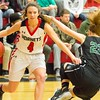Phoenix special photo by Shane Keeter<br /> Hilldale's Tyler McMillian creates some offensive space against Catoosa's Baylee Calico during Friday's game at the Hilldale Event Center. The Lady Hornets won 74-56.