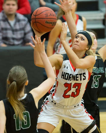 Phoenix special photo by Von Castor<br /> Hilldale's Katie Kirkhart, center, scores in the lane between Catoosa's Mercedes Baker, left, and Cheyenne Sanders during Friday's game.