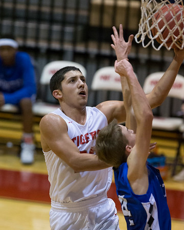 Phoenix special photo by Von Castor<br /> Fort Gibson's Rico Ybarra, left, drives in for a layup as Porter's Collin Plunk defends during Monday's opening-round game of the Old Fort Classic at Harrison Field House in Fort Gibson.
