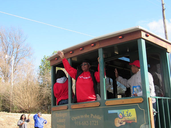 "Staff photo by Cathy Spaulding<br /> Martin Luther King Center Dream Team volunteer Mary Brice, center, repeatedly shouts ""What are you doing for others?"" from the back of a trolley. She joined other Dream Team volunteers and members on Monday to take part in the annual Martin Luther King Day Parade."