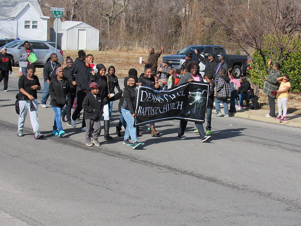 Staff photo by Cathy Spaulding<br /> People wave as Deans Chapel Baptist Church members march on Monday during the Martin Luther King Day parade.
