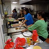 Special photo by Mike Elswick<br /> Representatives from different churches, clubs and other groups each week volunteer to provide and serve dinner to Bridges Out of Poverty class members in the kitchen of St. Paul United Methodist Church.