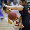 Phoenix special photo by Von Castor<br /> Fort Gibson's Alexis Wright left, looks to pass around Keys' Sydney Girdner during Tuesday's first-round game in the Old Fort Classic at Harrison Field House.